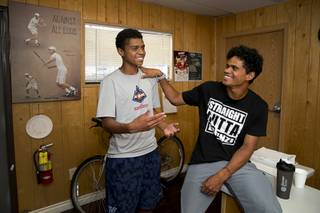 Rua Elmore, 16, stands by his brother Will Elmore, 23, during an interview at the No Quit Tennis Academy at Lorenzi Park Wednesday, Aug. 1, 2018.