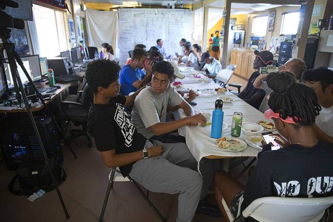Will Elmore, 23, and his brother Rua, 16, have lunch in the Marty Hennessy Inspiring Children Foundation headquarters at Lorenzi Park Wednesday, Aug. 1, 2018.