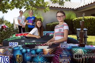 Gardiner and Gresko girls, from left, Riley Gresko, 10, Aubree Gresko, 7, Mckayla Gardiner, 13, and Alyssa Gardiner, 9, pose with their cars at the Gresko home in Henderson Saturday, Aug. 4, 2018. The family has four generations of Soap Box Derby champions. Riley recently finished third in the Stock Division in Akron, Ohio.