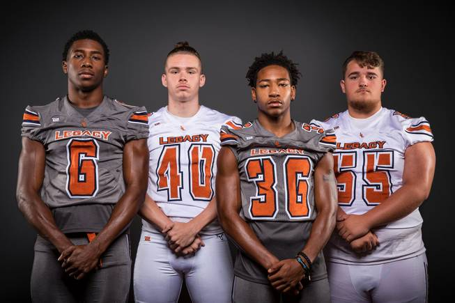 Members of the Legacy High football team pose for a photo at the Las Vegas Sun's high school football media day Tuesday July 31, 2018 at the Red Rock Resort and Casino. They include, from left, Jerry Martin, Jordan Goulet, Amorey Foster and Justin Lang.
