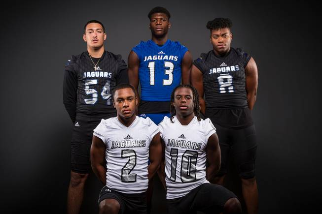 Members of the Desert Pines High football team pose for a photo at the Las Vegas Sun's high school football media day Tuesday July 31, 2018 at the Red Rock Resort and Casino. They include, top row, Gabriel Lopez, Darnell Washington, Dejon Pratt. Bottom row, Tye Moore and Devin McGee