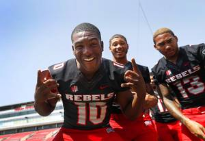 UNLV Rebels wide receiver Darren Woods Jr., left, (10), wide receiver Drew Tejchman, center, (11), and running back Tariq Hollandsworth (13) pose for a photo during UNLV Photo Day at Sam Boyd Stadium Wednesday, Aug. 8, 2018.