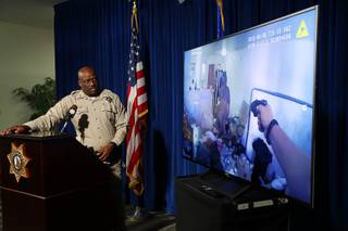 Assistant Sheriff Tim Kelly watches police body cam video during a briefing at Metro Police headquarters Thursday, Aug. 9, 2018. Police discussed the officer-involved shooting of Spurgeon Daniels at Kensington Suites, in the 2200 block of West Bonanza Road, Monday, Aug. 6. In this photo, an officer holds a Taser but the Taser was not effective, police said.