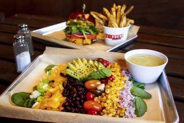 The Southwest Avocado Monsoon salad (front) and Cha Cha Burger with Rosemary Fries (back) from Blinders Burgers & Brunch