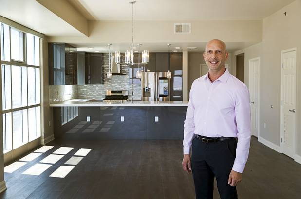 Uri Vaknin, a partner in KRE Capital, poses in a remodeled condo at the Ogden in downtown Las Vegas Tuesday, Aug. 21, 2018.