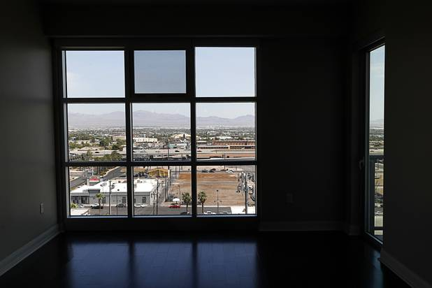 Downtown Las Vegas is viewed from an 11th floor, two-bedroom condo in the Ogden Thursday, Aug. 16, 2018.