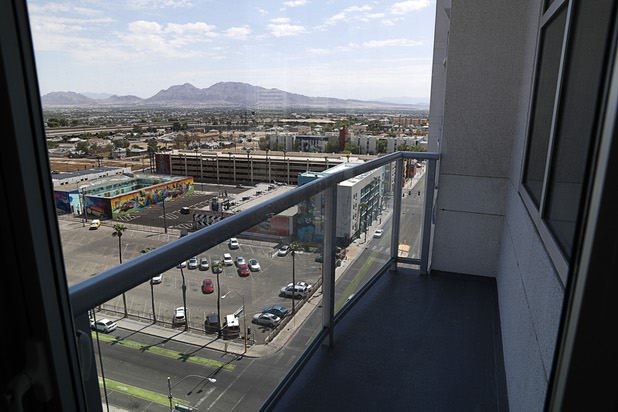 Downtown Las Vegas is viewed from the balcony of an 11th floor, two-bedroom condo in the Ogden Thursday, Aug. 16, 2018.