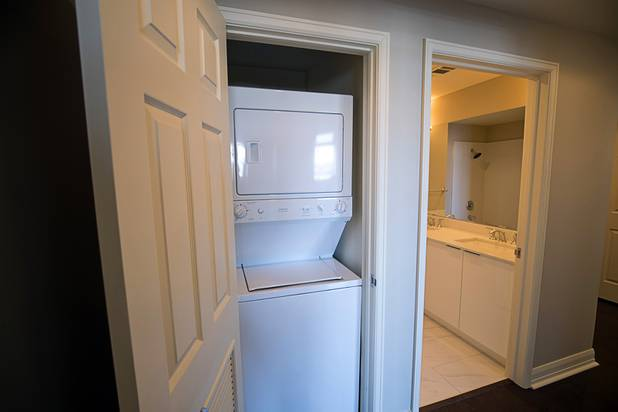 A small washing machine and dryer are hidden in a closet of a two-bedroom condo in the Ogden in downtown Las Vegas Thursday, Aug. 16, 2018.