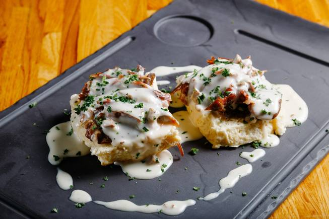 Biscuits and gravy with duck confit meat prepared by Chef Kevin Lopez, are seen here at Andre's Bistro and Bar, Thursday, Aug. 14, 2018.
