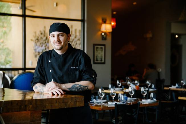 Chef Kevin Lopez poses for a photo at Andre's Bistro & Bar, Thursday, Aug. 9, 2018.