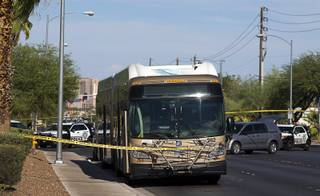 Metro Police vehicles are shown by an RTC bus during an officer-involved shooting investigation near Spring Mountain Road and Rainbow Boulevard Friday, Aug. 24, 2018. Police shot a man who is accused of randomly stabbing two women.