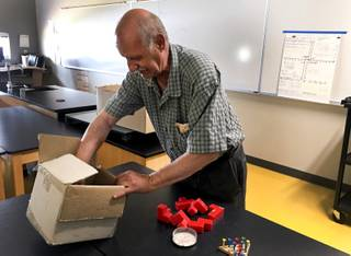 Clark County School District math teacher John Perri, 71, unpacks his teaching puzzles inside his classroom at Southwest Career and Technical Academy, Friday, August 10, 2018.