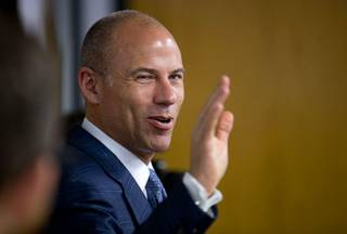 Attorney Michael Avenatti waves as he is introduced during a news conference at Battle Born Progress, a non-profit progressive advocacy organization, Friday, Aug. 31, 2018.