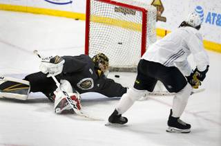 Golden Knights left wing Erik Haula (56) puts the puck into the net past goaltender Marc-Andre Fleury (29) during practice at the City National Arena in Summerlin Wednesday, Sept. 5, 2018.