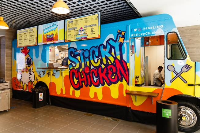 A Sticky Chicken food truck sits permanently parked at a new sports book and bar called The Book inside The LINQ, Wednesday, Sep. 5, 2018. More than 10 different wing combinations and sandwiches will be served.