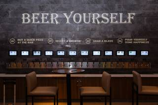 A self serve beer wall with 24 taps including lagers and IPAs is seen at a new sports book and bar called The Book inside The LINQ, Wednesday, Sep. 5, 2018.