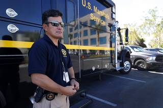 Gary Schofield, U.S. Marshal for the District of Nevada, poses outside a mobile command center during Operation STAR in Las Vegas Thursday, Sept. 6, 2018. The three-week operation led by the U.S. Marshals Service in Nevada led to the arrests of 135 suspects wanted in felonies, the agency said.