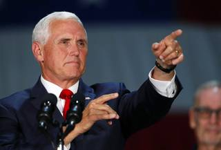 Vice President Mike Pence points to an audience member as he speaks during a visit to Nellis Air Force Base in Las Vegas Friday, Sept. 7, 2018.