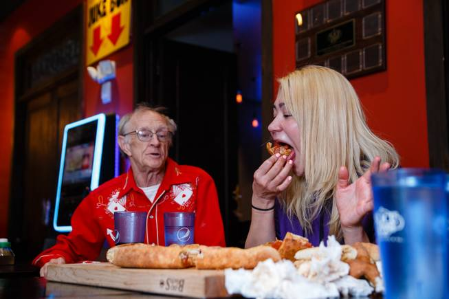 Competitive eater Miki Sudo, with fellow competive eater Rich LeFevre at her side, attempts Slice of Vegas Double Down Pizza Challenge inside Mandalay Bay, Thursday, Sep. 6, 2018. LeFevre completed the challenge in 38 minutes the day before.