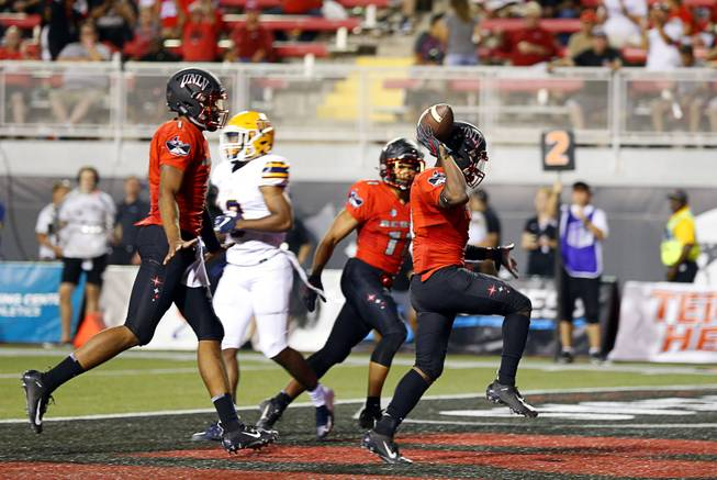 UNLV running back Lexington Thomas, right, (3) celebrates his second touchdown during a game against UTEP at Sam Boyd Stadium Saturday, Sept. 8, 2018.