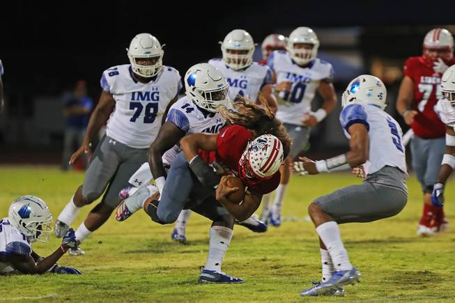 Liberty running back Zyrus Fiaseu (30) gets tackled while running the ball during a game against IMG Academy at Liberty High School, Friday, Sep. 7, 2018.