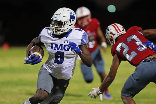 IMG Academy running back Trey Sanders (6) runs the ball during a game against Liberty at Liberty High School, Friday, Sep. 7, 2018.