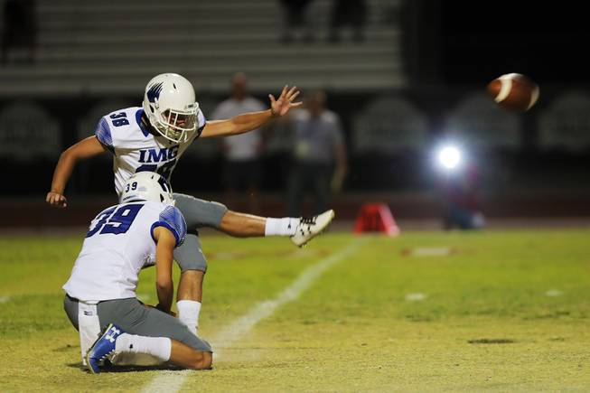 IMG Academy player Cameron Gillis (38) kicks for a field goal during a game against Liberty at Liberty High School, Friday, Sep. 7, 2018.