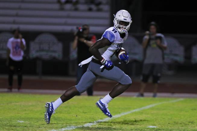 IMG Academy running back Michael Redding (11) runs into the end zone for a touchdown during a game against Liberty at Liberty High School, Friday, Sep. 7, 2018.
