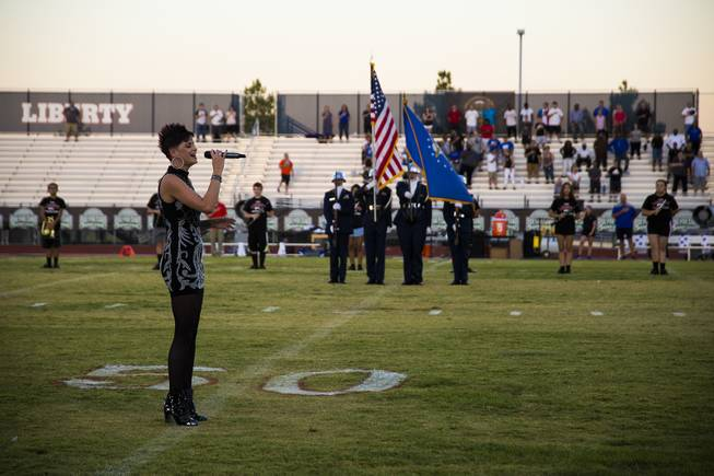 Singer Megan Ruger performs the national anthem prior to a Liberty vs IMG Academy game at Liberty High School, Friday, Sep. 7, 2018.