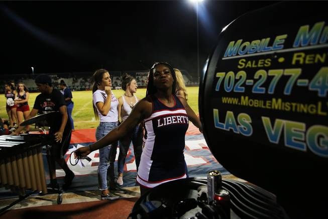 A Liberty cheerleader cools off during a game against IMG Academy, Friday, Sep. 7, 2018.