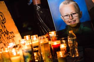 A photo of 8-year-old Levi Echenique is displayed during a candlelight vigil at Paradise Park, 4775 McLeod Dr., Sunday, Sept. 9, 2018. Echenique was killed by a suspected impaired driver in a traffic accident on Aug. 31 at at Eastern and Harmon avenues.