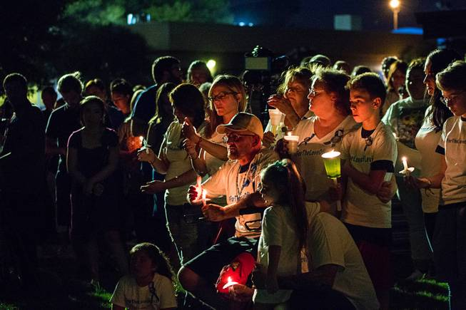 Over 200 friends and family members gather during a candlelight vigil for 8-year-old Levi Echenique at Paradise Park, 4775 McLeod Dr., Sunday, Sept. 9, 2018. Echenique was killed by a suspected impaired driver in a traffic accident on Aug. 31 at at Eastern and Harmon avenues.