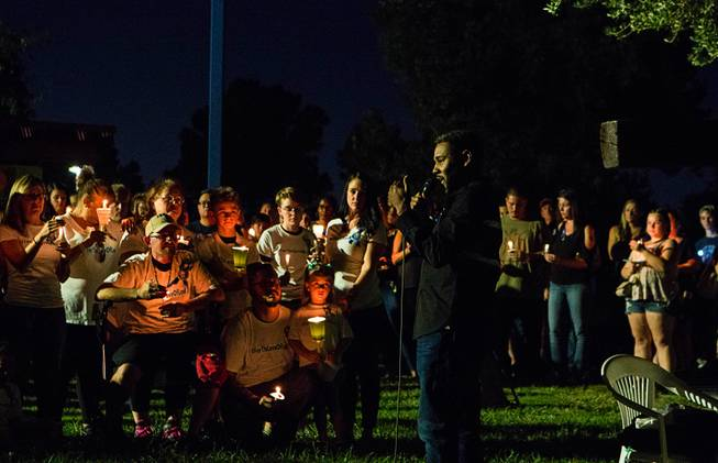 Cameron Miller speaks during a candlelight vigil for 8-year-old Levi Echenique at Paradise Park, 4775 McLeod Dr., Sunday, Sept. 9, 2018. Echenique was killed by a suspected impaired driver in a traffic accident on Aug. 31 at at Eastern and Harmon avenues.