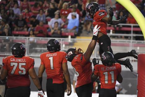 UNLV Rebels running back Lexington Thomas (3) is lifted up after scoring against the UTEP Miners during their NCAA football game Saturday, September 8, 2018, at Sam Boyd Stadium in Las Vegas.