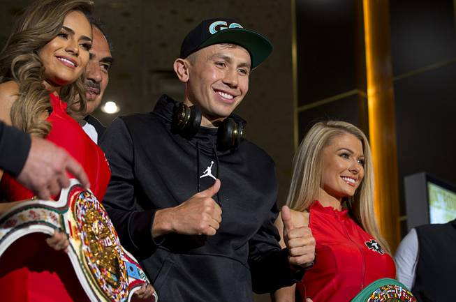 WBC/WBA middleweight champion Gennady Golovkin, center, of Kazakhstan gives two thumbs up in the lobby of the MGM Grand Tuesday, Sept. 11, 2018. Golovkin will defend his titles against Canelo Alvarez of Mexico in a rematch at T-Mobile Arena in Las Vegas on Sept. 15.