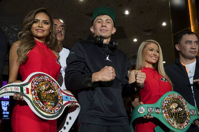 WBC/WBA middleweight champion Gennady Golovkin, center, of Kazakhstan poses in the lobby of the MGM Grand Tuesday, Sept. 11, 2018. Golovkin will defend his titles against Canelo Alvarez of Mexico in a rematch at T-Mobile Arena in Las Vegas on Sept. 15.