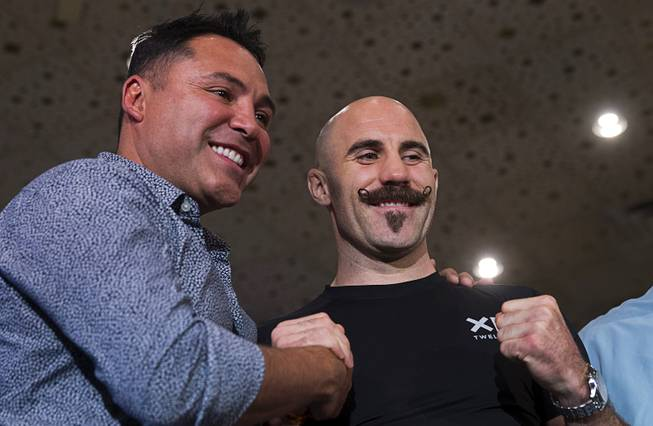 Boxing promoter Oscar De La Hoya, left, poses with middleweight boxer Gary O'Sullivan of Ireland in the lobby of the MGM Grand Tuesday, Sept. 11, 2018. Lemieux will fight Gary O'Sullivan of Ireland in a middleweight bout at T-Mobile Arena in Las Vegas on Sept. 15.
