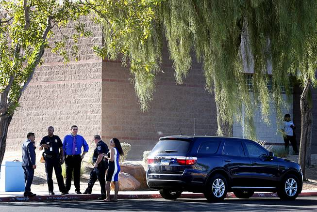 Police and officials with the Clark County School District and North Las Vegas Police confer after a fatal shooting at a ball field at Canyon Springs High School in North Las Vegas Tuesday, Sept. 11, 2018.