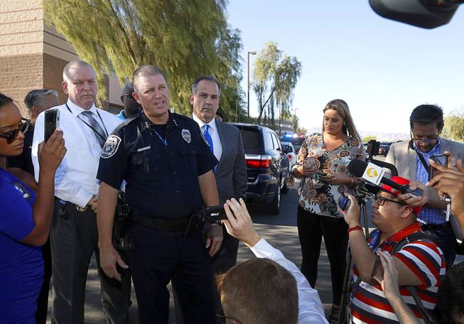 Acting North Las Vegas Police Chief Justin Roberts responds to questions from reporters after a fatal shooting at a ball field at Canyon Springs High School in North Las Vegas Tuesday, Sept. 11, 2018.