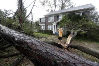 Mike Kiernan takes photos of the damage to his home in Wilmington, N.C., after Hurricane Florence made landfall Friday, Sept. 14, 2018. (AP Photo/Chuck Burton)