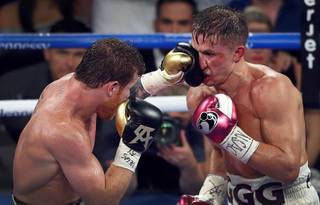 Canelo Alvarez, left, of Mexico lands a punch on WBC/WBA middleweight champion Gennady Golovkin of Khazakstan during their title fight at T-Mobile Arena Saturday, Sept. 15, 2018. Alvarez took Glolovkin's WBC/WBA titles by majority decision. STEVE MARCUS