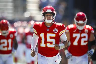 Kansas City Chiefs quarterback Patrick Mahomes runs onto the field before an NFL football game against the Los Angeles Chargers Sunday, Sept. 9, 2018, in Carson, Calif.