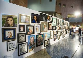 Portraits honoring the 58 victims of the Oct. 1 shooting are displayed as part of the Las Vegas Portraits Project exhibit at the Clark County Government Center in Las Vegas on Monday, Sept. 17, 2018.