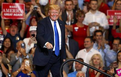 President Donald Trump leaves the stage at the conclusion of his rally at the Las Vegas Convention Center Thursday, Sept. 20, 2018.