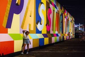 Festivalgoers have their picture taken in front of one of the many murals that can be found throughout the festival grounds during the first day of the Life is Beautiful music festival in downtown Las Vegas, Friday, Sept. 21, 2018.