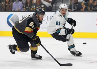 Vegas Golden Knights center Jonathan Marchessault (81) and San Jose Sharks defenseman Justin Braun (61) vie for the puck during the first period of a preseason NHL hockey game Sunday, Sept. 30, 2018, in Las Vegas.