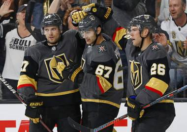 Golden Knights defenseman Shea Theodore, left, and center Paul Stastny, right, celebrate after left wing Max Pacioretty, center, scored against the San Jose Sharks, Sunday, Sept. 30, 2018, in Las Vegas.