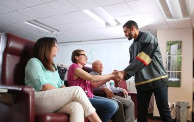 Vegas Golden Knights player Pierre-Édouard Bellemare meets with patients at Comprehensive Cancer Center's Henderson clinic.