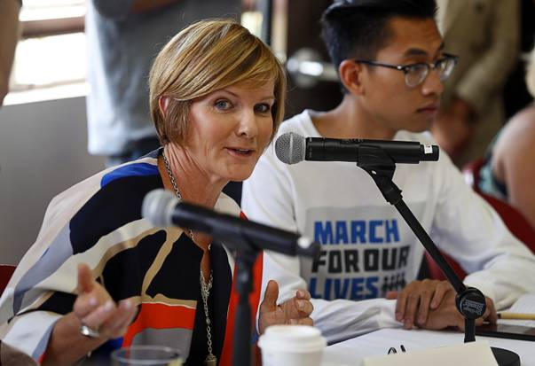 "Susie Lee, Democratic candidate for the 3rd Congressional District, speaks during a gun violence roundtable with Capt. Mark Kelly, his wife former Arizona Congresswoman Gabrielle ""Gabby"" Giffords, gun violence survivors, student activists, and community leaders at UNLV Tuesday, Oct. 2, 2018."
