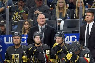 Vegas Golden Knights head coach Gerard Gallant, center, watches play in the second period during the Knight's season opener against the Philadelphia Flyers at T-Mobile Arena Thursday, Oct. 4, 2018.